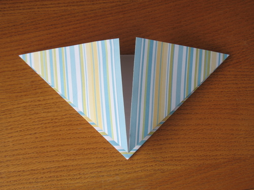 Fold all four corners the same way.